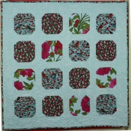 Inspired by the beautiful colours in this fabric range - a simple design for a modern quilt
