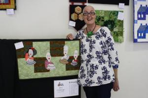 "Trudy with her challenge quilt entry ""Journey through  Chemo"""