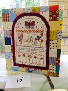Jan cleverly made a beautiful stitchery and some squares into a wonderful file book cover