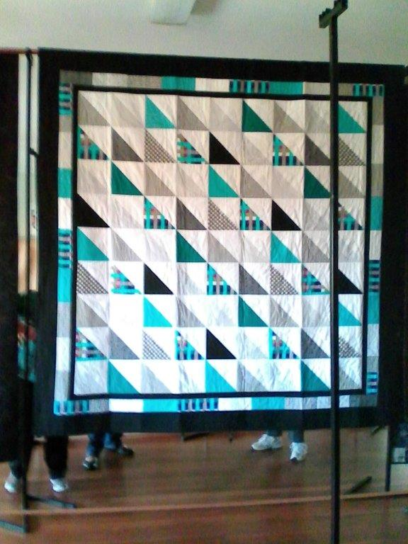 Maureen's modern quilt made with multiple half square triangles -nice one Maureen